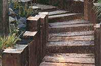 Railway ties used as retaining walls and steps