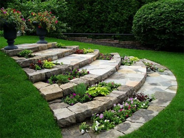 Curved stone steps double as plant beds