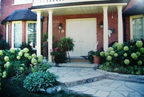 Front of home with exceptional landscaping
