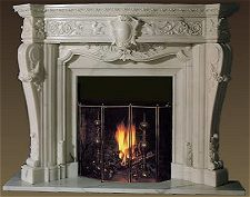 Ornate marble fireplace mantel and surround