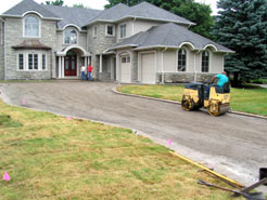 Using a twin drum roller to compact the driveway foundation layer
