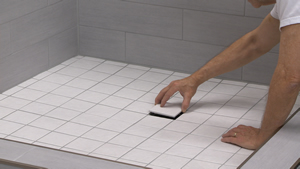 Schluter®-Systems Tileable 4 inch Grate being installed