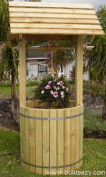 full size wishing well provides a place for a planter