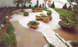 A picturesque accessible garden. It uses a variety of shapes to construct correctly sized raised planters