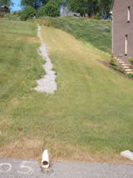 French drain used to control the direction of water run-off from on a hill.