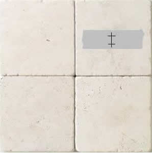 ceramic tile with duct tape marked for drilling